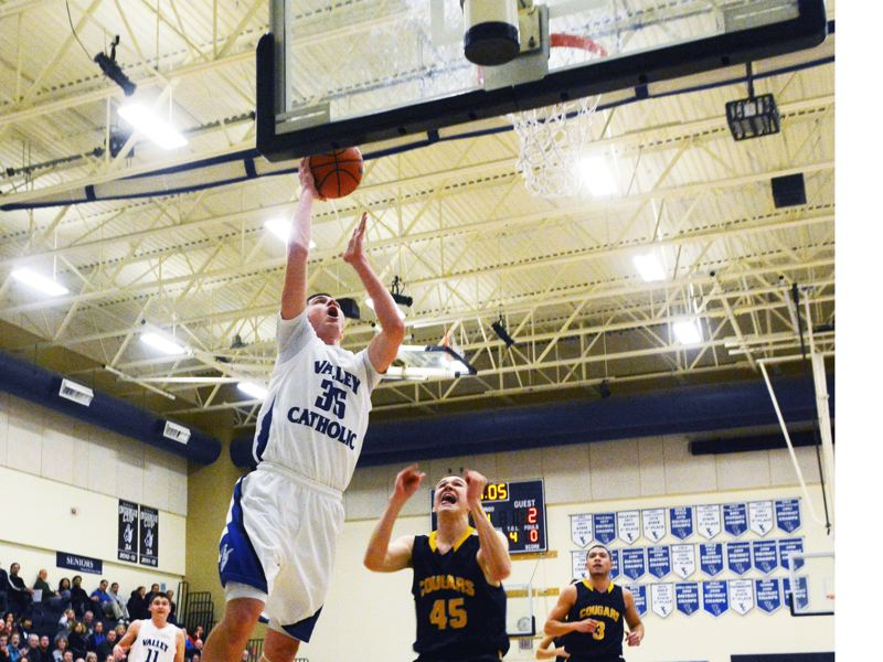 by: TIMES PHOTO: MATT SINGLEDECKER - Valley Catholic senior post Gabe Taylor had 20 points and 10 rebounds for the Valiants.
