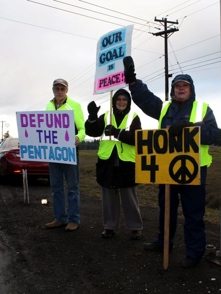 by: POST PHOTO: KYLIE WRAY - Honk for peace signs were the reason for several honks in the intersection throughout the hour. Each was met with a smile and a wave.
