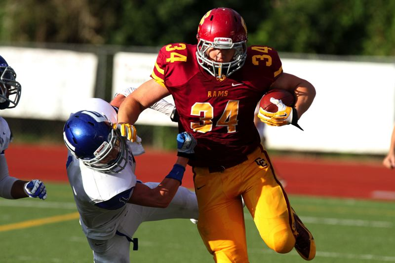 by: TRIBUNE FILE PHOTO; JONATHAN HOUSE - Ryan Nall of Central Catholic stiff-arms a Grant defender in the 2013 season opener.