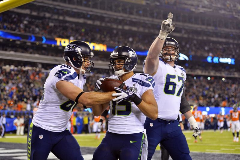 by: COURTESY OF MICHAEL WORKMAN - Seattle Seahawks receiver Jermaine Kearse (center) celebrates his 23-yard touchdown reception with teammates Zach Miller (left) and Derrick Coleman. The play gave Seattle a 36-0 lead in the third quarter of Sundays Super Bowl XLVIII.