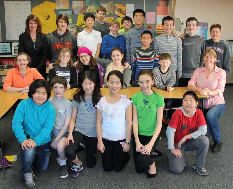 by: REVIEW PHOTO: JILLIAN DALEY - The Lake Oswego Junior High Debate Club has about two dozen active members. Pictured are, from left, back row: Parent volunteer Ann Lininger, Andrew Samuelson, Joshua Yoon, Andrew Johnson, Lance Pancoast, Noah Slobodin, James Liu, Trevor Li (directly in front of James Liu), Michael Murray, Nathan Thornberg and Alex Sol; middle row: Grace Cook, Tiffani Thomason, Rachel Michtom, Hannah Bland, Cian Savoy and teacher Aletia Cochran; front row: Amy Park, Dan Michtom, Amy Wang, Doris Yang, Julia Lininger-White and Christopher Sun.