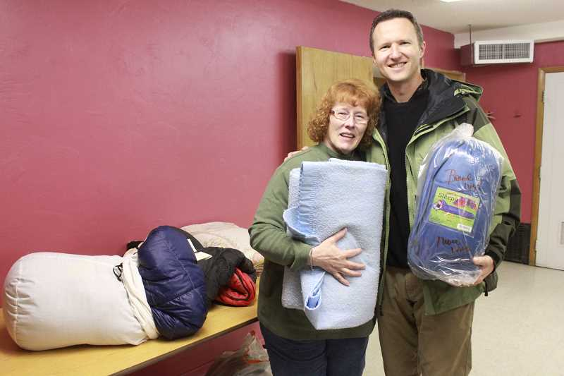 Doris McLean, with Central Oregon Veterans Outreach, passes out blankets and sleeping bags with guest observer Keith Harris, with VA homeless programs in Washington, D.C.