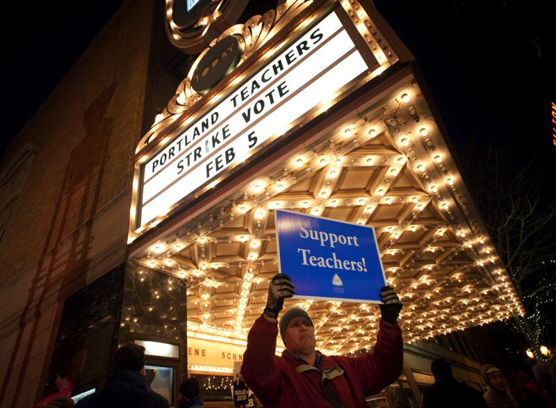 by: TRIBUNE PHOTO: ADAM WICKHAM - David Child, a member of the Portland Teachers Association bargaining team, held a sign outside the Schnitzer Concert Hall Wednesday evening during a rally to support teachers as a possible strike looms. The teachers union voted to authorize a strike, which could begin Feb. 20.