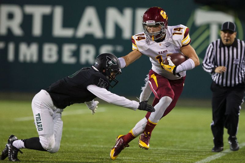 by: TRIBUNE FILE PHOTO: JAIME VALDEZ - Central Catholic receiver Holden Oglesbee avoids a Tigard tackler during the Class 6A semifinals.