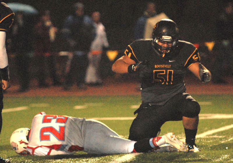 by: TRIBUNE FILE PHOTO: JONATHAN HOUSE - Semise Kofe of Roosevelt High celebrates a tackle against Ashland in the Class 5A playoffs.