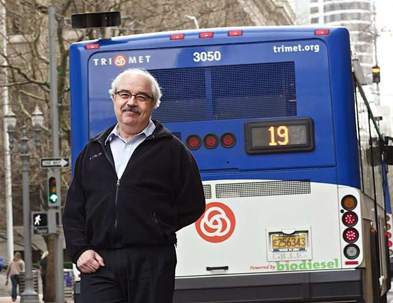 by: TRIBUNE PHOTO: JAIME VALDEZ - Kevin Downing, who runs DEQ's Clean Diesel Initiative, says some TriMet buses, like this one, filter most diesel pollution.