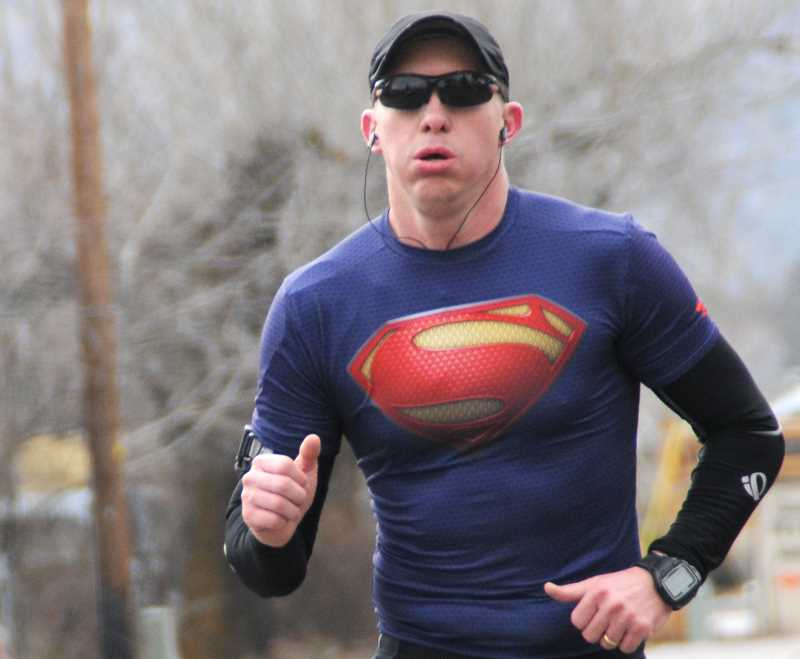 by: LON AUSTIN/CENTRAL OREGONIAN - Brandon Brasher, of Prineville, nears the finish line of the 10-mile division of the Super Bowl Sunday Dam Run. Brasher finished third in the race with a time of 1:07:14
