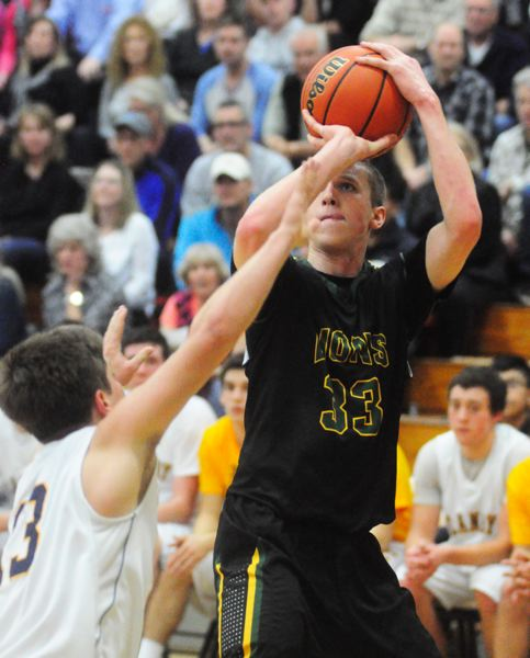 by: MATTHEW SHERMAN - Hayden Coppedge knocks down a jump shot in West Linn's road win over Canby last week.
