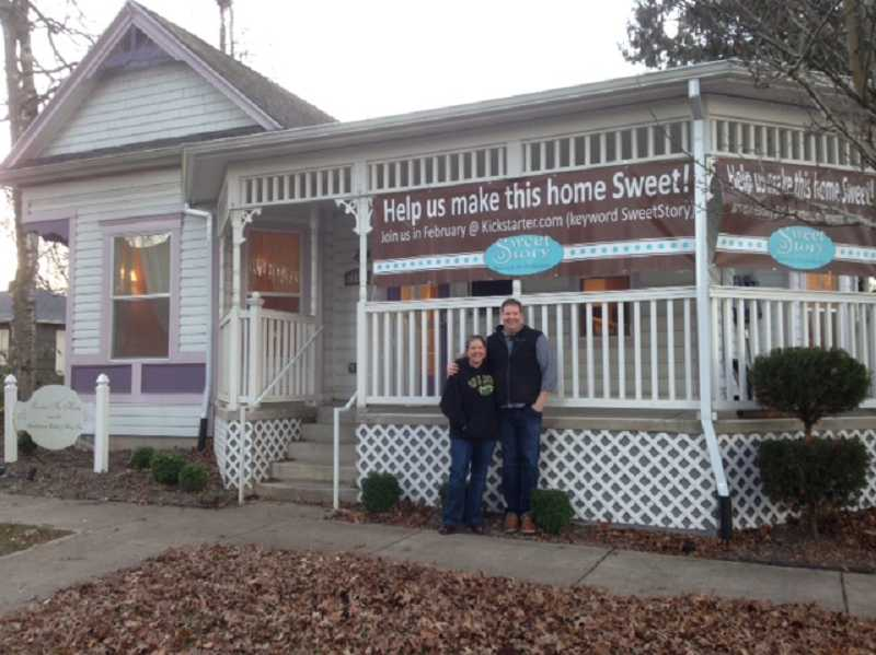 by: COURTESY OF AMBER GARDNER - Michele and Daron Howard stand in front of what they hope will be the new home for Sweet Story Bakery. Visit Kickstarter.com and click on Sweet Story to help them out.