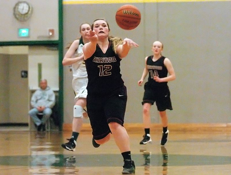 by: DAN BROOD - PASSING AHEAD -- Sherwood High School sophomore Josie Funk passes the ball up court during the first half of Tuesday's game at Putnam. The Lady Bowmen fell 44-30.