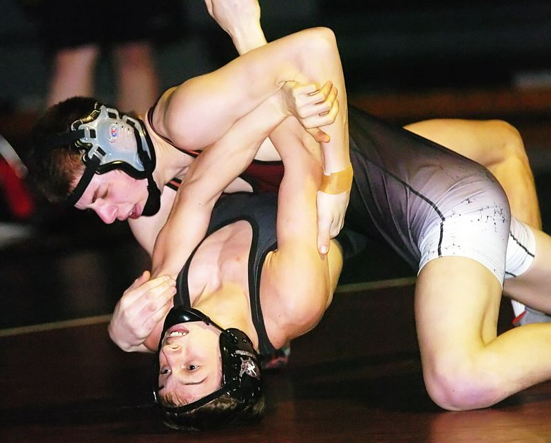 by: DAN BROOD - HEAD DOWN -- Sherwood senior Garret Heckenberg (top) forced Sandy's Blane Hays to the mat during their 145-pound match.