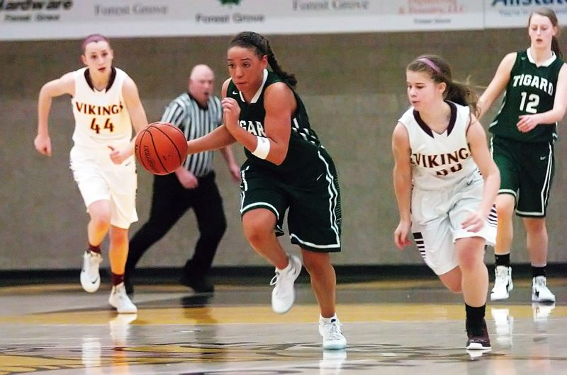 by: DAN BROOD - THERE SHE GOES -- Tigard senior Lexi Carter heads up court in a hurrdy during the Tigers' win at Forest Grove.