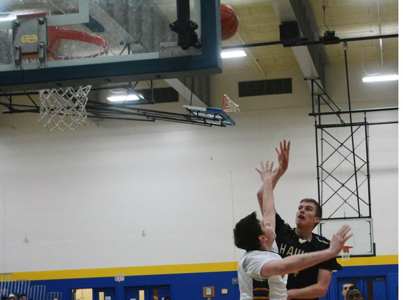 by: TIMES PHOTO: MATT SINGLEDECKER - Southridge post Griff Christiansen scored 11 points including two three pointers during the Skyhawks 65-46 rout of Aloha on Wednesday.