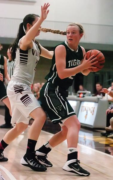 by: DAN BROOD - KEEPING CONTROL -- Tigard High School junior Kaylie Boschma (right) doesn't let Forest Grove's Shelby Turner get near the ball in Friday's game. Boschma scored 10 points for the Tigers in their 52-36 win.