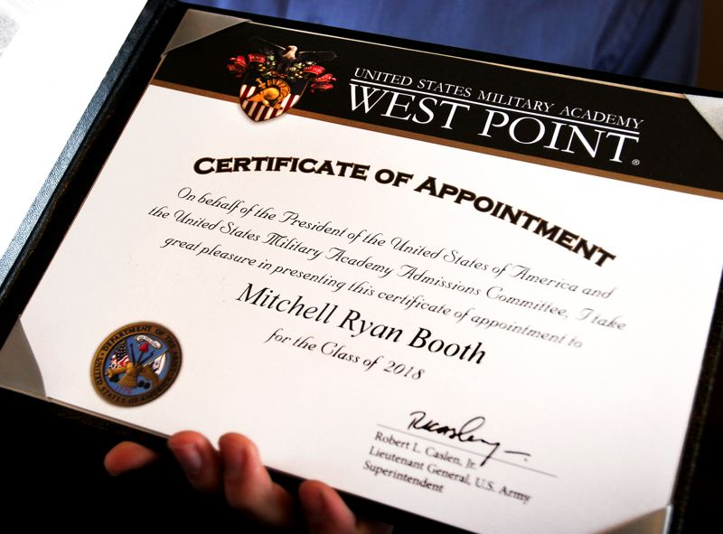 by: OUTLOOK PHOTO: JIM CLARK - Booth's 'big fat envelope' included his official West Point appointment and a congratulatory letter. Appointees call it 'The Holy Grail' and 'The Golden Ticket' of the military academy.
