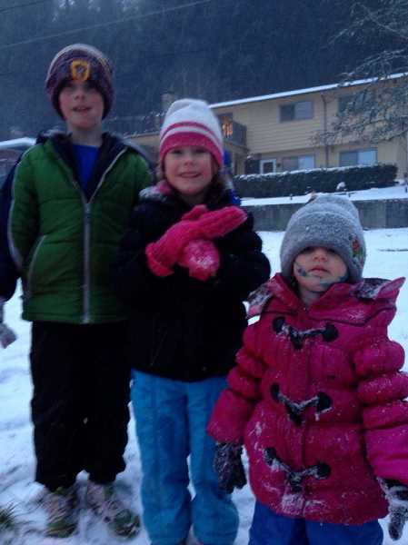 by: SUBMITTED PHOTO: AMBER NURMI - J.D., Anna, and Esmee Nurmi enjoy the snow at Midhill Park.