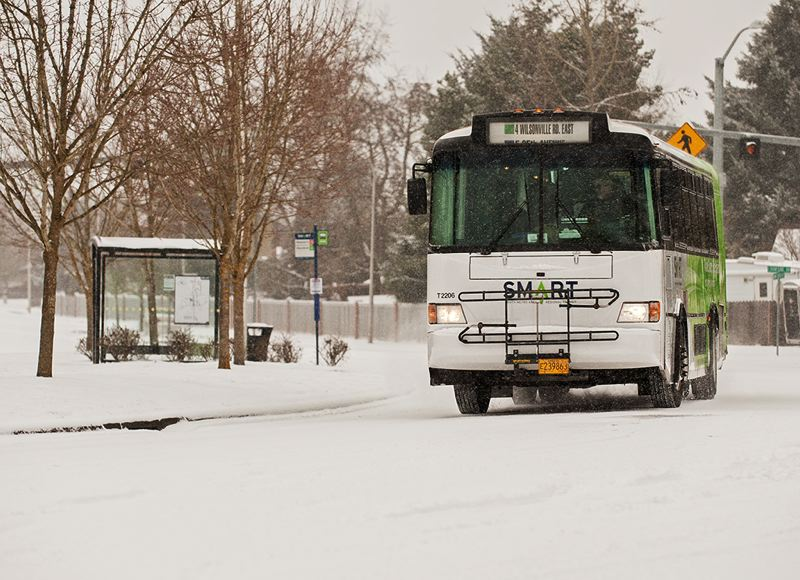 by: SPOKESMAN PHOTO: JOSH KULLA - SMART buses like this one on Town Center Loop Friday morning were kept in operation despite the weather. Wilsonville Police reported few commuting problems Friday, which was a relief for a city heavily dependent on Interstate 5.