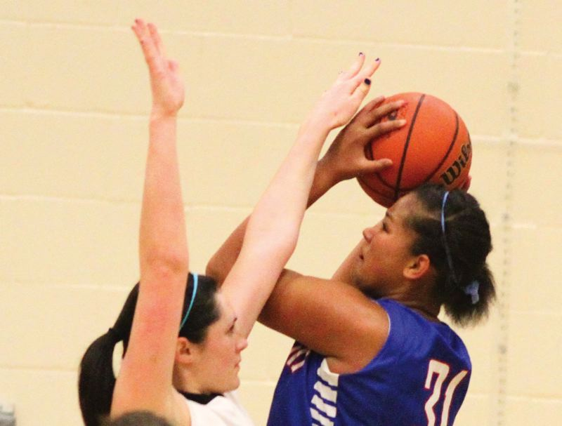 by: HILLSBORO TRIBUNE PHOTO: CHASE ALLGOOD - Hilhi's Tarea Green gets off a shot during Tuesday's dramatic 42-41 victory against city rival Century.