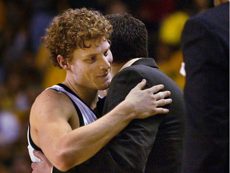 by: TRIBUNE FILE PHOTO: JIM CLARK - Luke Ridnour receives a hug as he leaves the court in 2003 in what would be his final home game as an Oregon Duck.