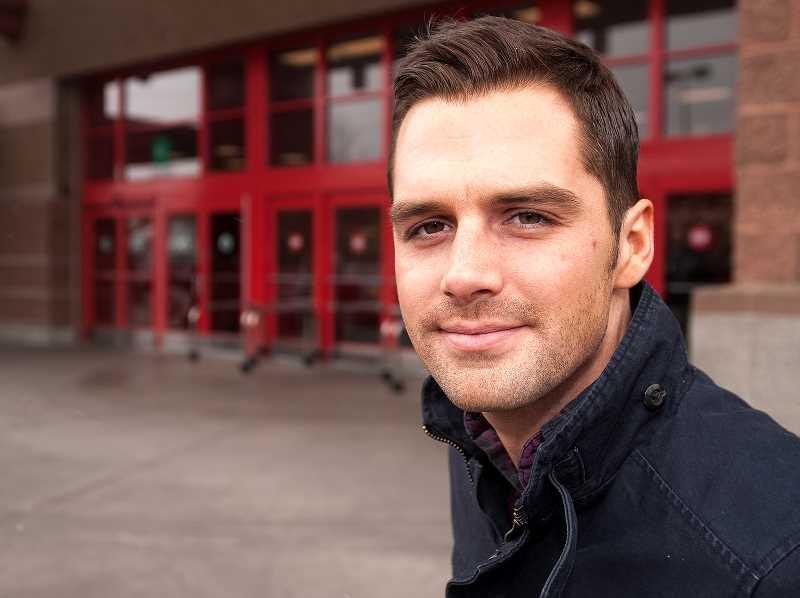 by: SPOKESMAN PHOTO: JOSH KULLA - Tom Smith, pictured here outside the Wilsonville Target where he works, recently saved the life of philanthropist Arlene Schnitzer using the Heimlich maneuver. Smith says he just acted out of instinct and does not feel like he did anything heroic.