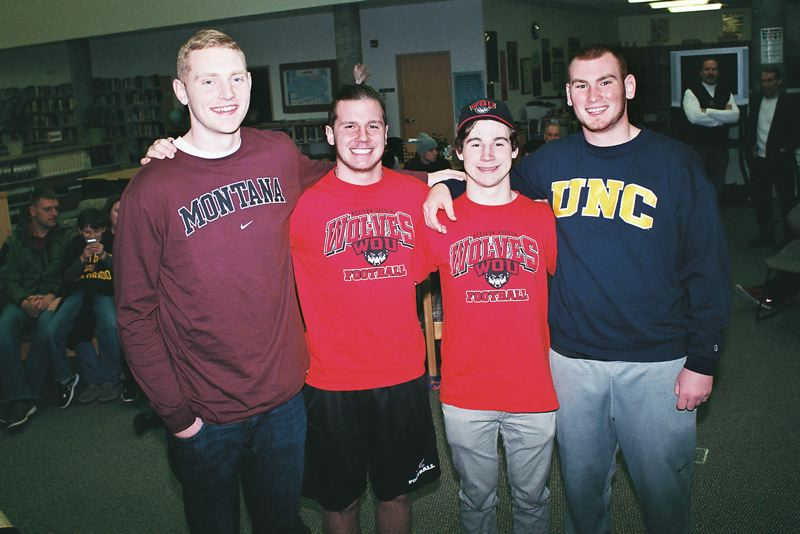 by: JOHN DENNY - The Clackamas High School community last week celebrated the decisions of four top football players to accept scholarships to play football in college. Pictured are (from left): David Reese, Zach Farnes, Dan Smiley Sherrell and Brody Haehlen.