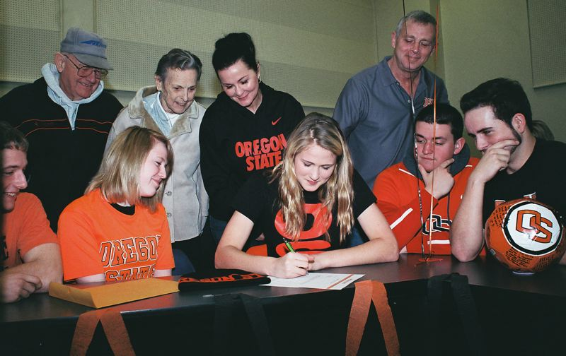 by: JOHN DENNY - Friends and family joined Rex Putnam senior Bella Geist at the high school on Feb. 5 to celebrating Geists signing of a letter of intent to play soccer at Oregon State University. Pictured are: (front, from left) Elliot Bixby, Caprial Sides, Bella, Daniel Gilbert and Joey Cardinal; and (back) grandparents Lee and Sally Creech, and parents Alyson and Dean Geist.