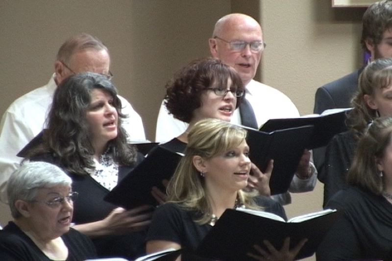 by: PHOTO COURTESY: JON CUMINGS - Clackamas Community Choir last year performs 'Who Do You Say I Am' on Palm Sunday weekend.