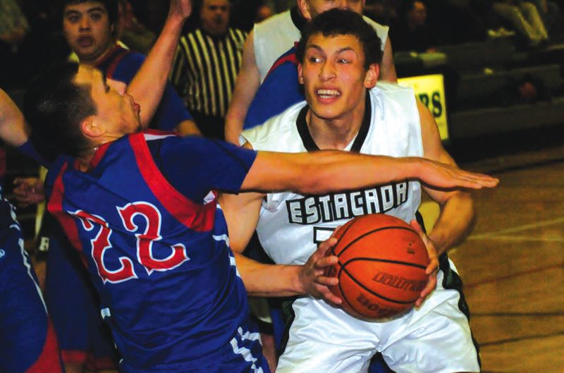 by: ESTACADA NEWS: PARKER LEE - Estacadas Alec Barstad works to get inside against Madras during last weeks home loss.