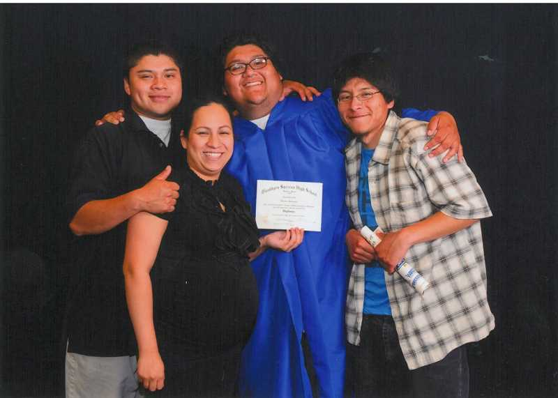 by: WOODBURN SCHOOL DISTRICT - This photo from spring 2013 shows Ricardo Hernandez with his family at graduation from Success High School in Woodburn.