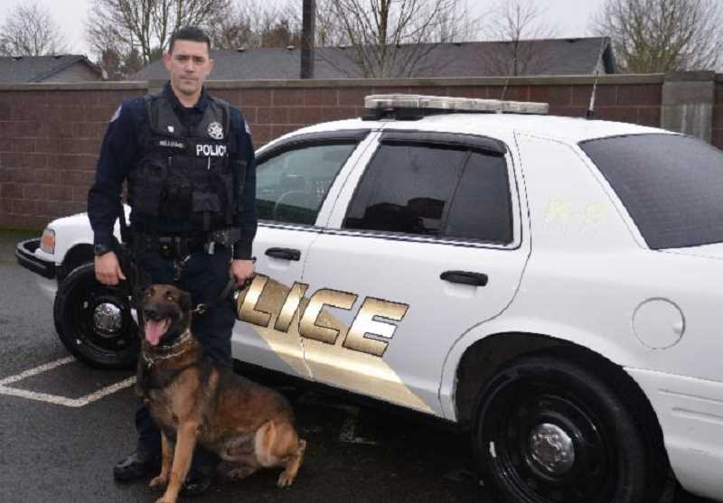 by: MAYGAN BECKERS - Max, one of the Woodburn Police Department's K-9 units, is pictured with his handler and partner Officer Zach Williams. Max died Jan. 31 after complications from a brief illness.