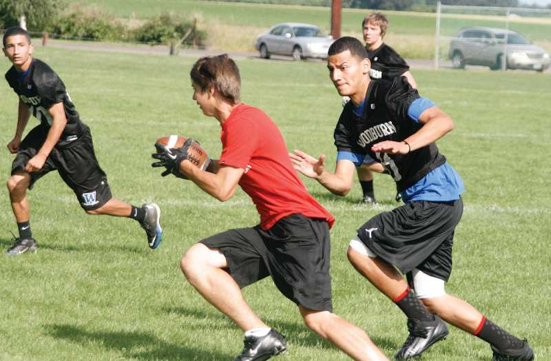 by: PHIL HAWKINS - The Woodburn varsity football team spent many hours last summer playing seven-on-seven passing games and working out in the weight room. Coach Nick Federico would like to see similar opportunities to play available for kids in elementary school by reviving Woodburn's youth football program this year.