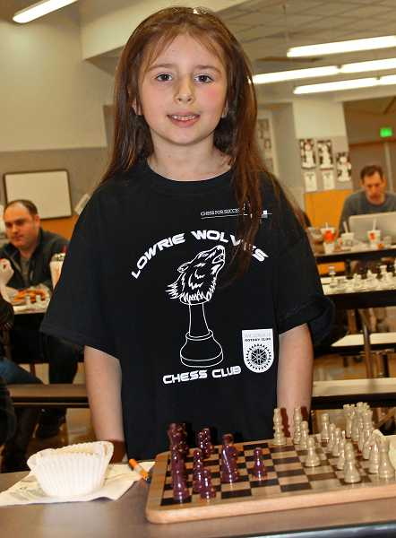 by: SPOKESMAN PHOTO: KATE HOOTS - Sophia Steinkamp, 7, takes a break between games at the Chess for Success regional tournament held Feb. 1 at Boones Ferry Primary School.