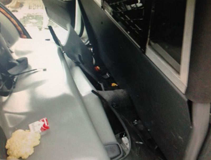 by: PORTLAND POLICE BUREAU - Ruben Turner inadvertantly locked himself in the back seat of a police car overnight.