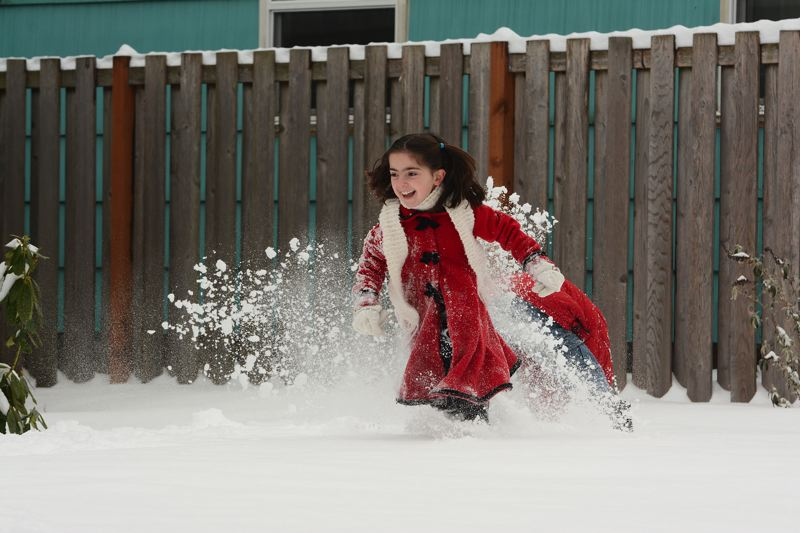 by: SPOTLIGHT PHOTO: JOHN WILLIAM HOWARD - A brother and sister battle it out in the snow in Scappoose Friday, Feb. 7. The pair were on their way home from their weekly trip to the library and stopped to have a bit of fun in the yard of a friend.