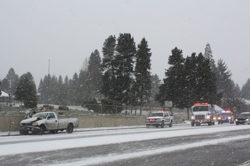 by: SPOTLIGHT PHOTO: ROBIN JOHNSON - Emergency vehicles respond to the scene of a wreck on Highway 30 in south Scappoose Thursday, Feb. 6.