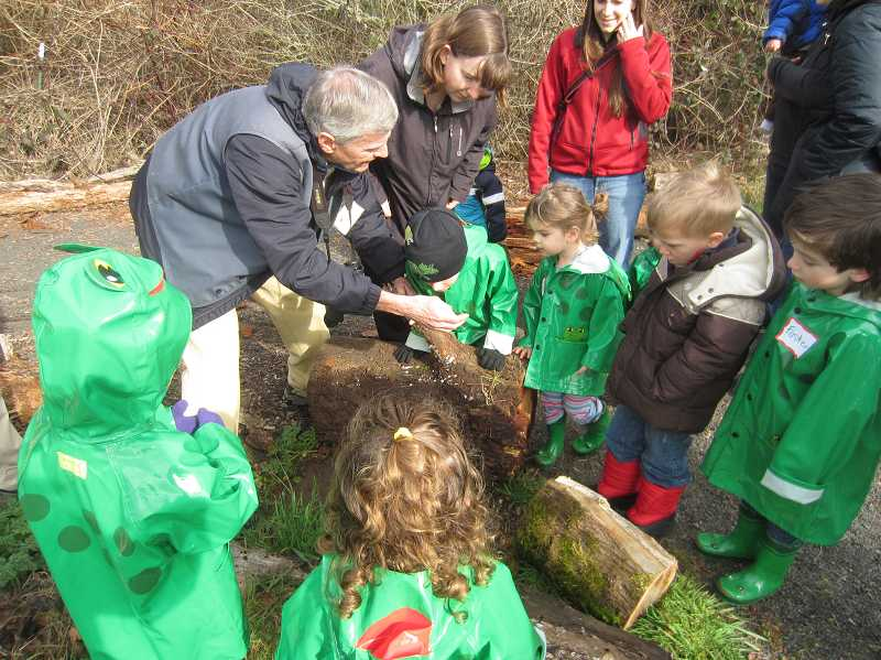 by: COURTESY OF TUALATIN RIVER NATIONAL WILDLIFE REFUGETTED PHOTO - Volunteer naturalists from the Friends of the Tualatin River National Wildlife Refuge share time with a group of toddlers during the refuge's very popular 'Puddle Stompers' program.