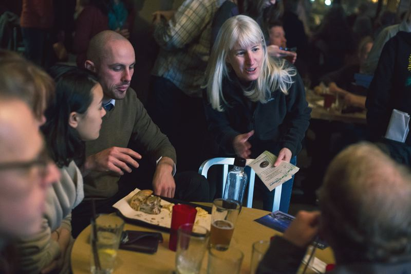 by: PAMPLIN MEDIA GROUP PHOTOS: JONATHAN HOUSE - Jan Wilson (above) is executive director of EarthShare Oregon, and a board member of Oregon Wild. At a recent Oregon Wild meeting (right), Wilson chats with participants about donating to EarthShare.