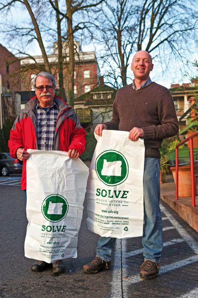 by: TRIBUNE PHOTO: JAIME VALDEZ - Wayne Wirta and Rob Fullmer volunteer at the regular SOLVE cleanup event in Northwest Portland.