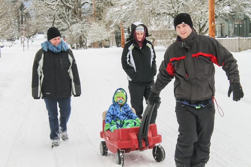 by: NEWS-TIMES PHOTO: JOHN SCHRAG - Eighteen-month-old Jaxton Urie enjoyed a ride around Forest Grove's Roger Park on Friday morning with his dad, Chris Urie, his mom, Amanda Breiland and his grandmother, Amber Breiland.