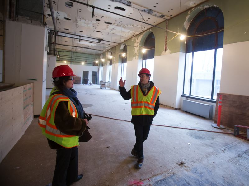by: TRIBUNE PHOTO JONATHAN HOUSE - Renovation progress is everywhere as PNCA Director of Communications & Public Programs Becca Biggs, left, talks with Director of Institutional Research Gus Baum in 511 Federal Building.