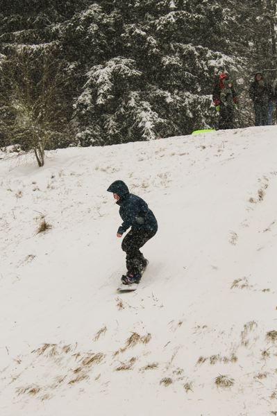 by: NEWS-TIMES PHOTO: JOHN SCHRAG - Bailey Grigsby, 16, got in some snowboarding practice Friday afternoon behind Tom McCall Upper Elementary School. She was joined later by her younger sister, Megan. Both girls attend Forest Grove High School.