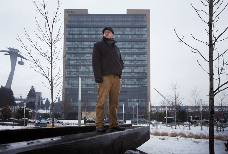 by: TRIBUNE PHOTO: JONATHAN HOUSE - Steve Hughes, state director of Oregon Working Families, stands in front of OHSUs South Waterfront building, near a proposed facility for the Knight Cancer Research Center. Hughes says city leaders need to pay more attention to fostering jobs for working-class people.