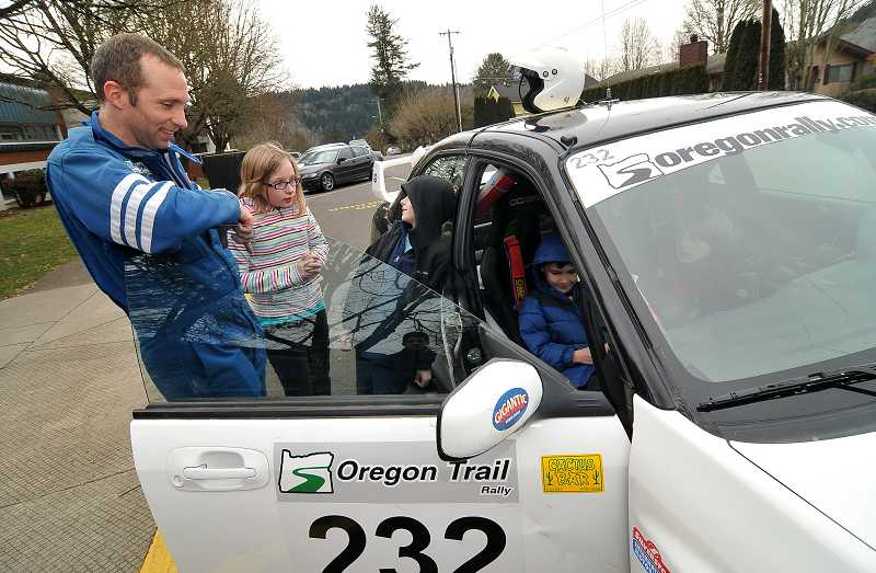 by: TIDINGS PHOTO: VERN UYETAKE - Tabor brought his newest car to Read to Us day at Willamette Primary School, where he read 'If I Built a Car' to students.