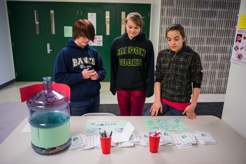 by: NEWS-TIMES PHOTO: CHASE ALLGOOD - Skyler LaMotte, Mariah Fields and Christian Fields of Banks Junior High School handle a fundraising booth at lunchtime. Money will aid classmate Joe White, who remains at a Portland rehab center after suffering a stroke.