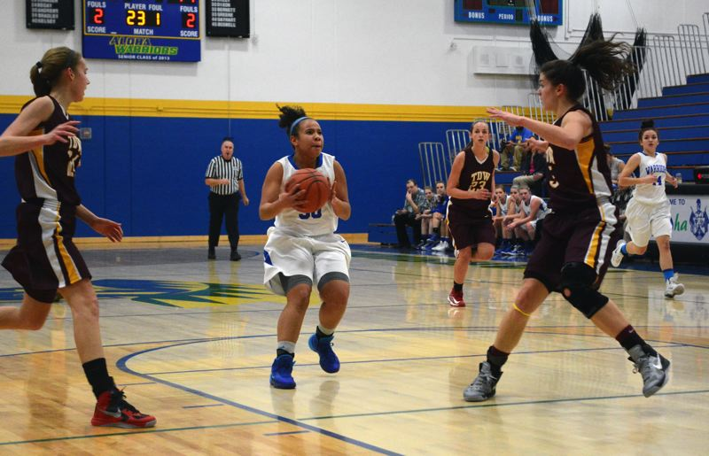 by: TIMES PHOTO: MATT SINGLEDECKER - Aloha senior Demetria Andrews and the Warriors are currently in fifth place in the Metro League.
