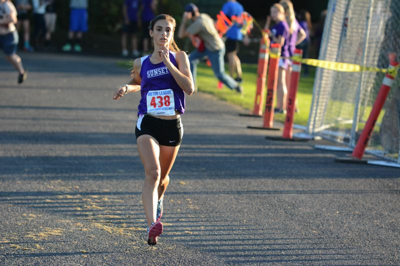 by: TIMES PHOTO: MATT SINGLEDECKER - Sunset girls cross country runner Charlotte Corless will continue her running career at Boise State University.