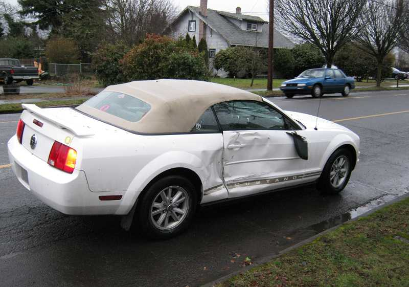 by: MOLALLA POLICE OFFICER CURTIS THORMAN - The school bus crashed into the passenger side of this Ford Mustang, which was northbound on Molalla Avenue.