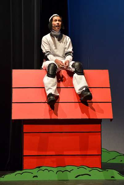 by: REVIEW PHOTO: VERN UYETAKE - Eliott Wells plays Snoopy, Charlie Browns imaginative dog.