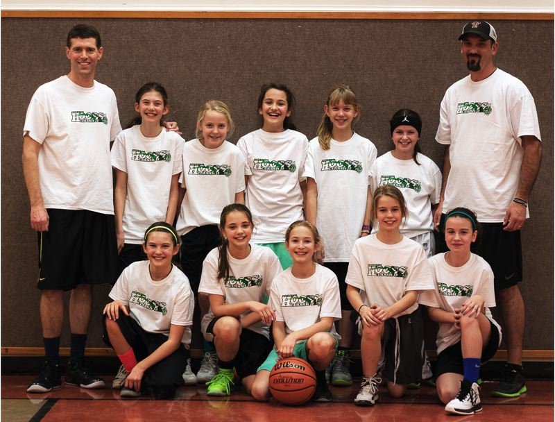 by: SUBMITTED PHOTO - CHAMPS -- The Tualatin fifth-grade Classic girls basketball team won the title at the Putnam Invitational.
