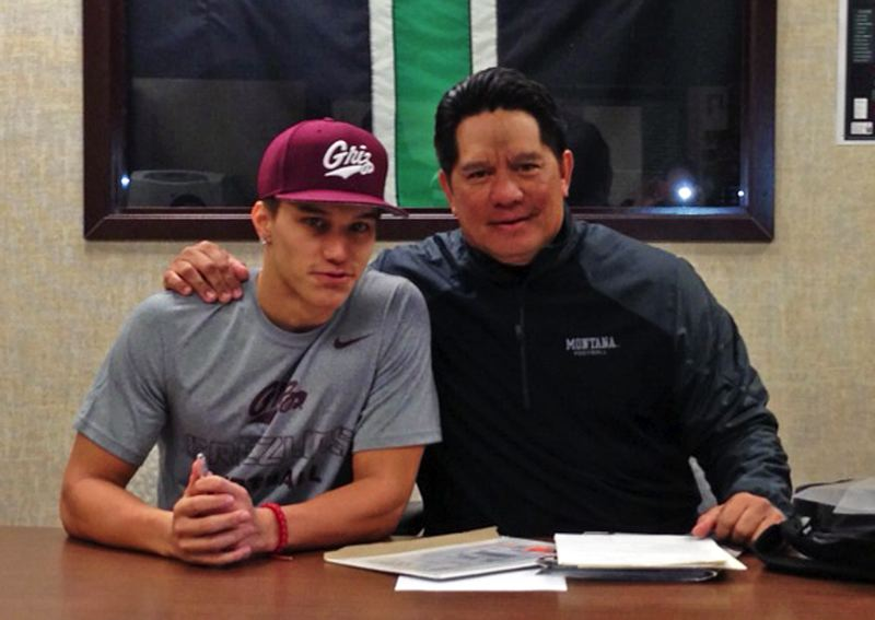 by: SUBMITTED PHOTO - MONTANA BOUND -- Tigard senior Manu Rasmussen (left), with his father John Rasmussen, signed a national letter of intent to play college football at the University of Montana.